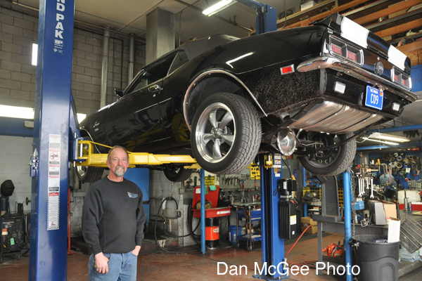Hot August Nights type of cars, as well as older vehicles are a part of his business. Here Tom Hauptman stands in one of the service bays his business has.
