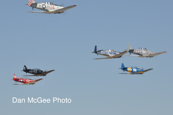 National Championship Air Races - Dennis Buehn (43) leads the T-6 charge with Nick Macy (6) on his right.