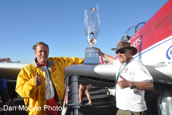 National Championship Air Races - Hoot Gibsone and owner Tiger Destefani with the winner's trophy.