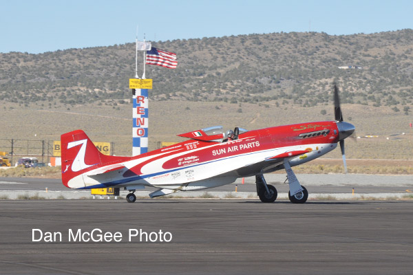 National Championship Air Races - Hoot Gibson in Strega wins the Unlimited Gold race.