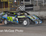 Robert Miller taking a victory lap after winning at 95A Speedway.